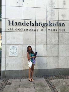Estella stands in front of the University of Gothenburg