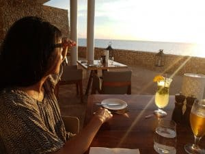Corinne Rootsey having a drink during sunset