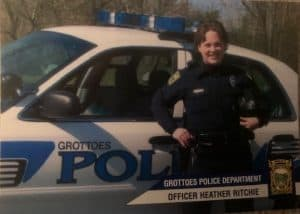 Heather standing in front of a police car