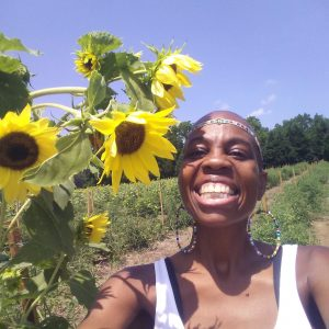 A selfie on Evon with some sunflowers in the field